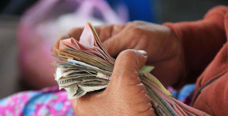 Cash in pair of hands