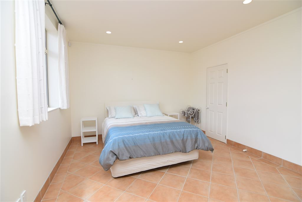 Lower level bedroom with ensuite and balcony