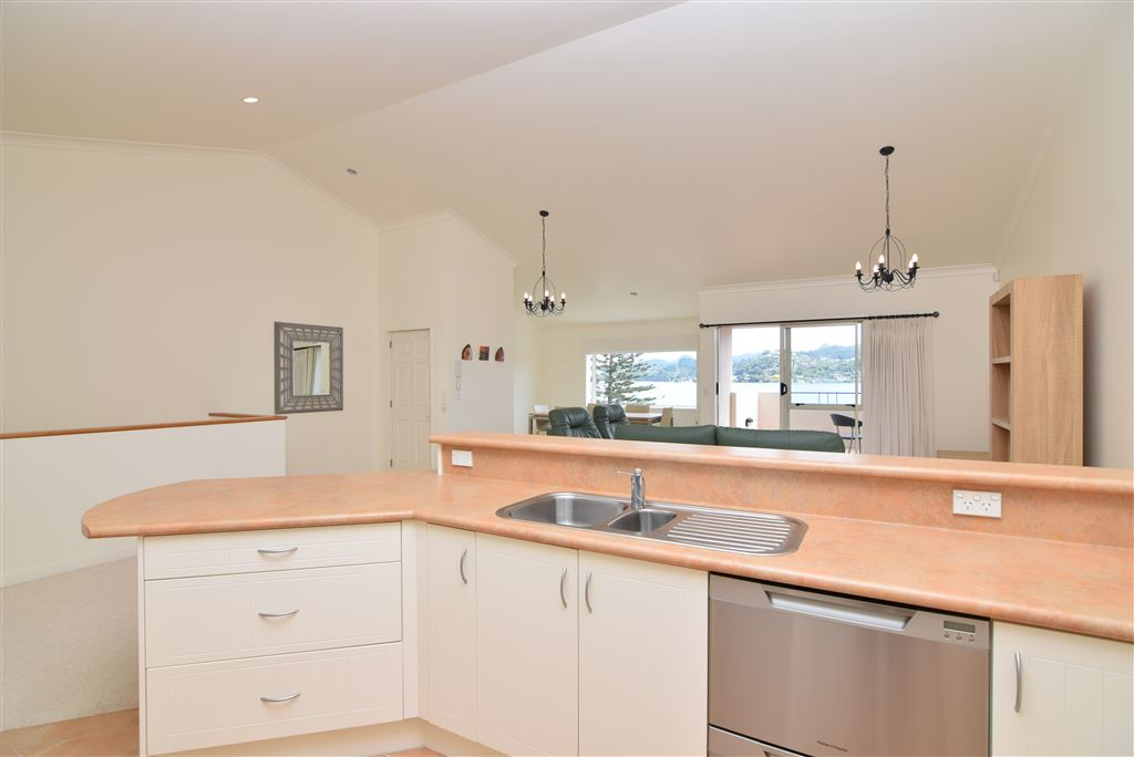 Top level, kitchen and lounge with Harbour views