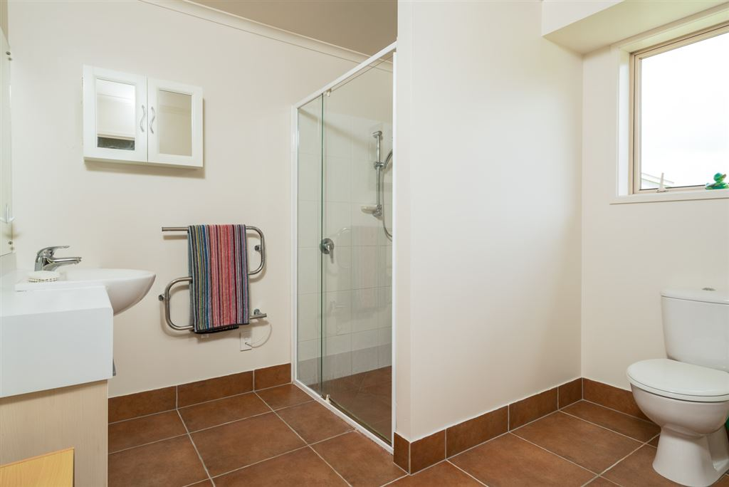 Ensuite bathroom, which is beside a walk in robe accessible for the master bedroom only.