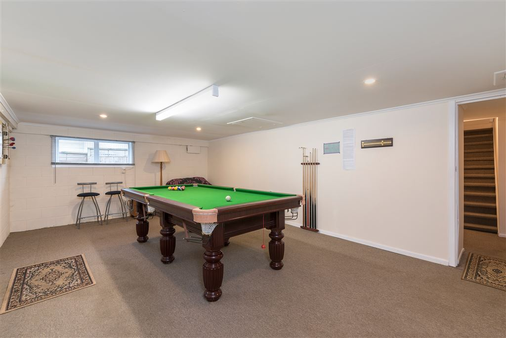 Downstairs games/pool room comes complete with pool table as a chattel