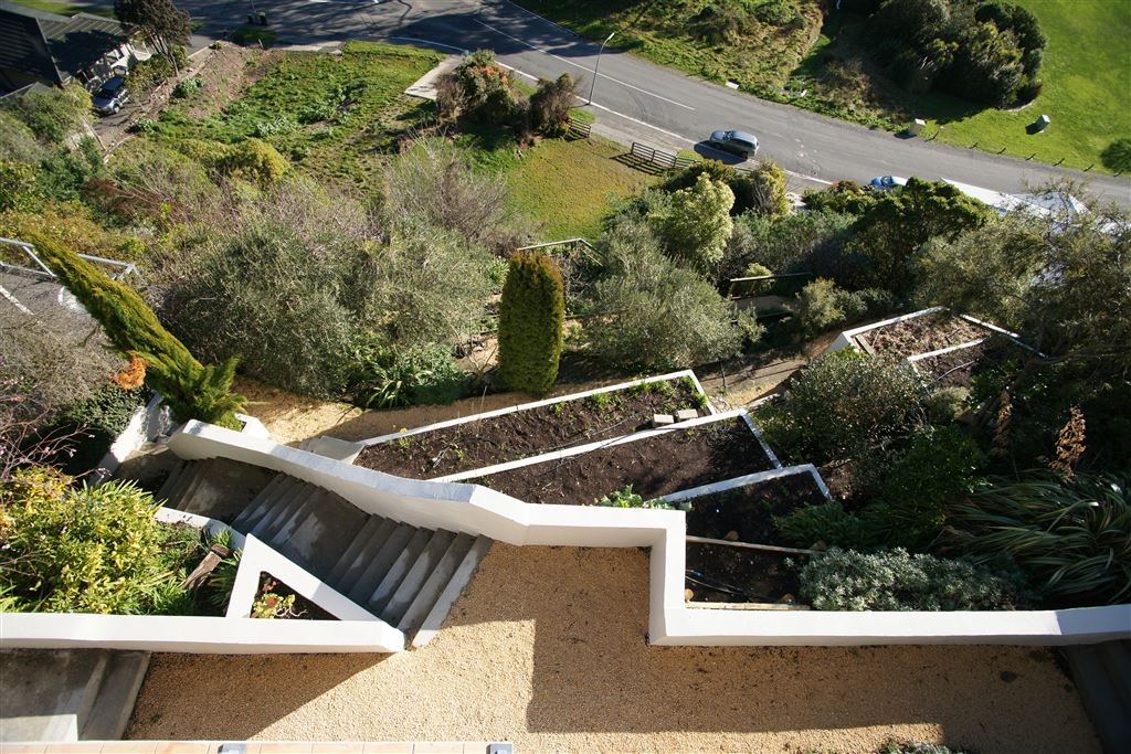 Birds eye view of the terraced grounds from the dining area balcony