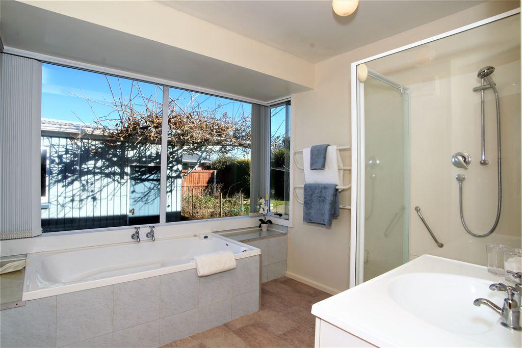 Bathroom, with spa bath & rear garden outlook