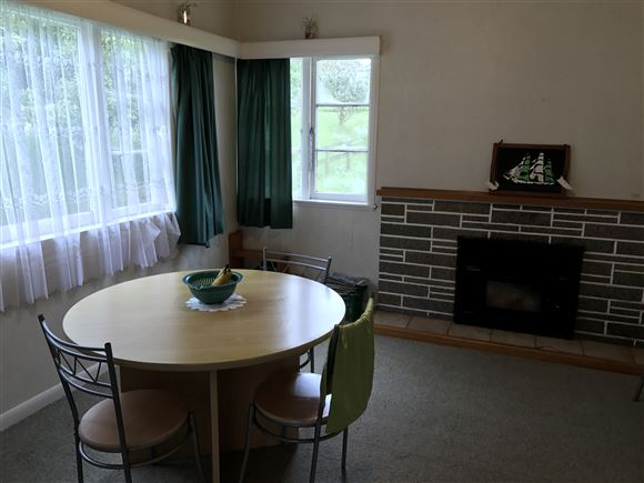 Separate dining room with fireplace that requires annual check