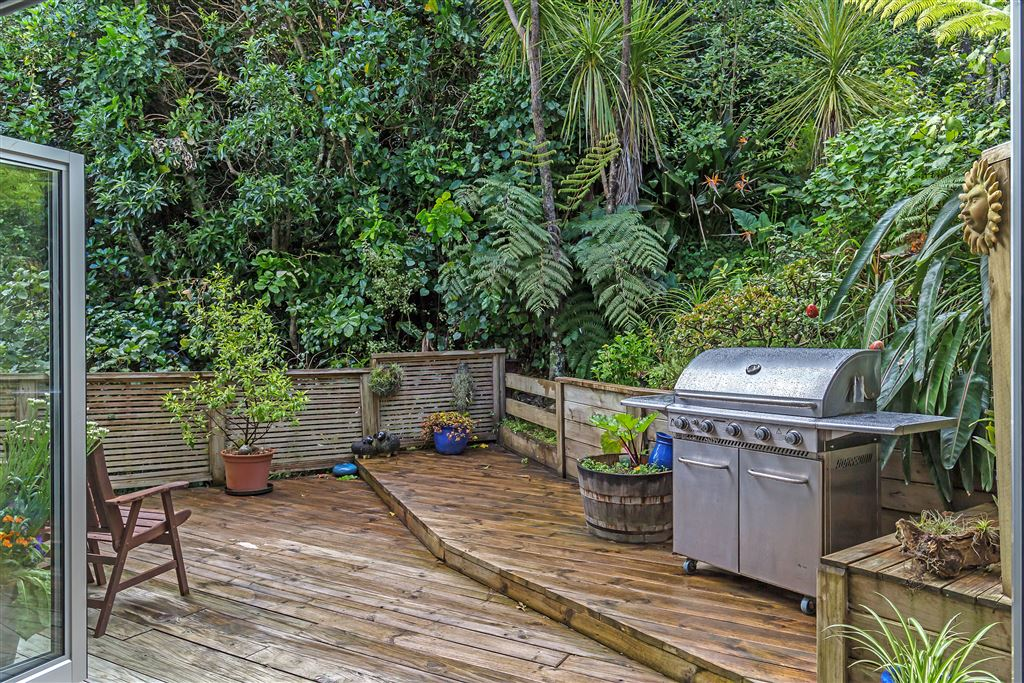 Enjoy the peace and tranquility on this deck, surrounded by lush bush.