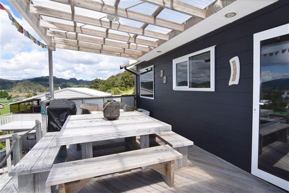 Upper deck level with kitchen servery window