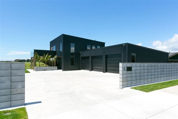 Contemporary, Near New And 3 Car Garage