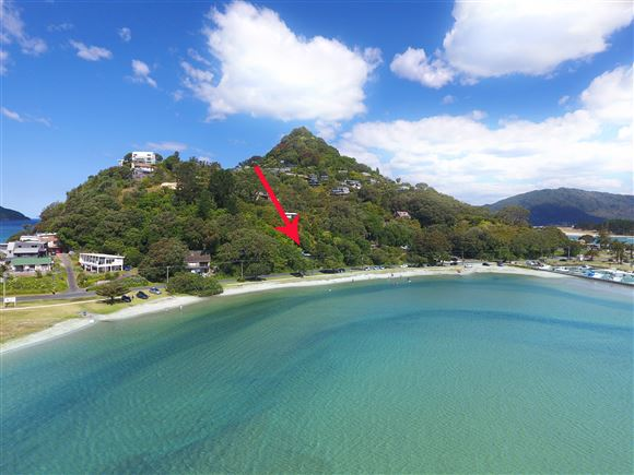 Located at the base of Mt. Paku, at the edge of the Tairua Harbour