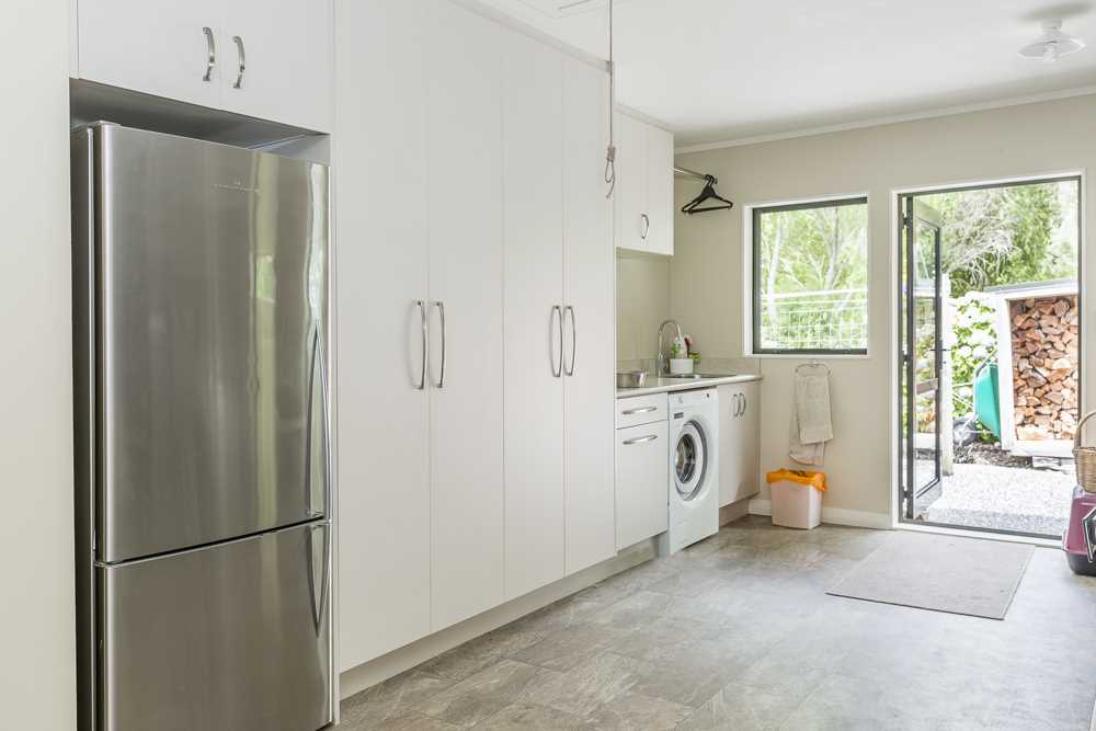 Double garage with laundry and built in storage