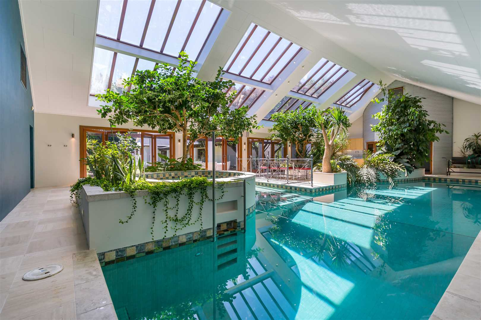 An indoor pool complex or resort quality