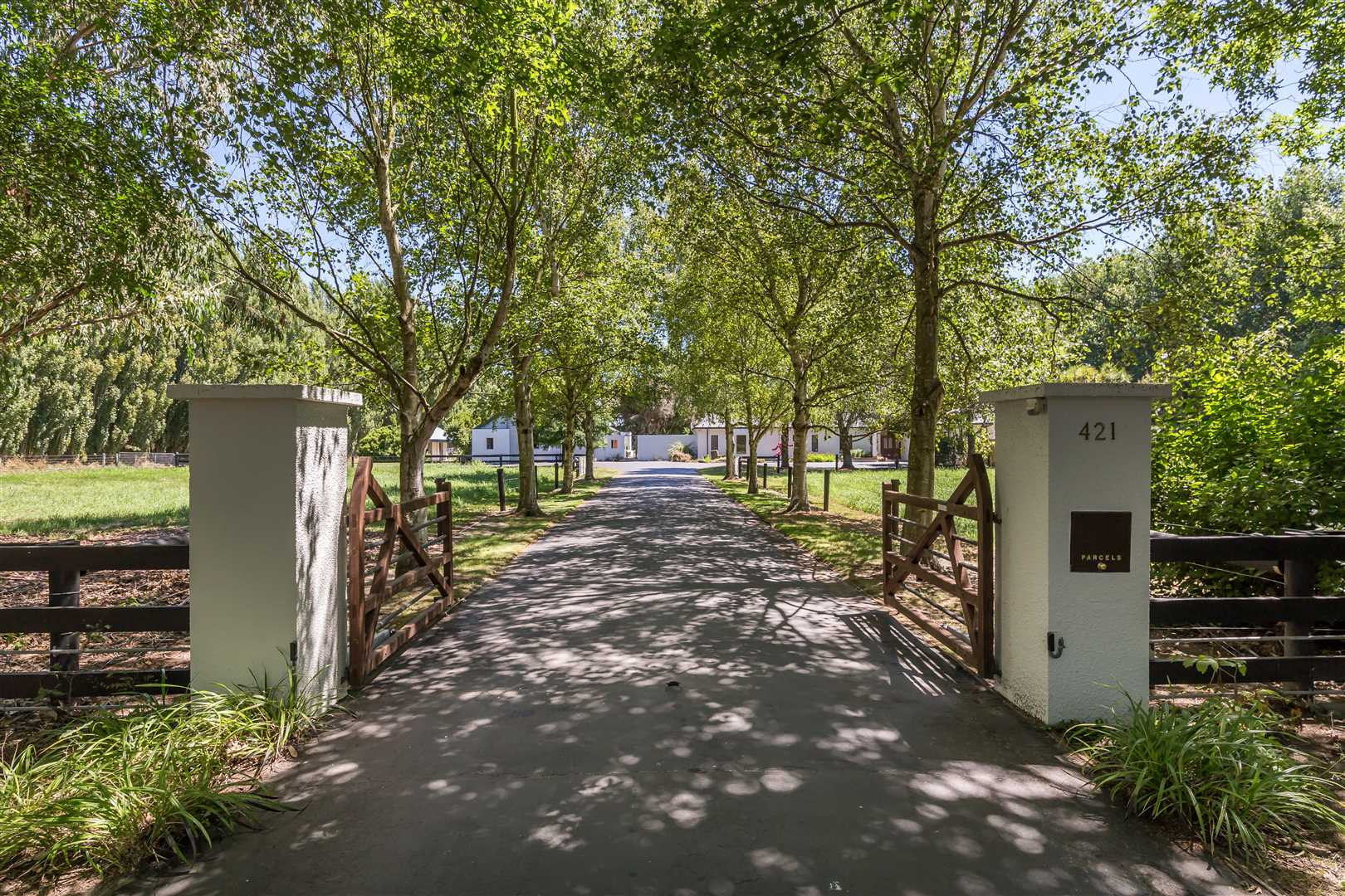 The classic tree lined entrance with electronic gates to a very special property