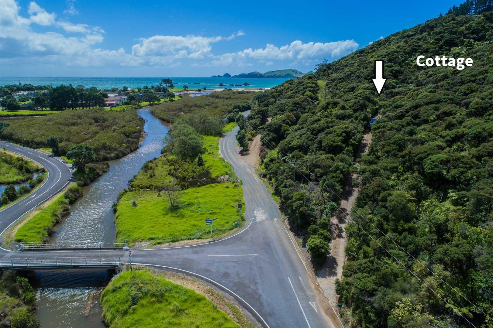 Tauranga Bay - bush, cottage and sea views!