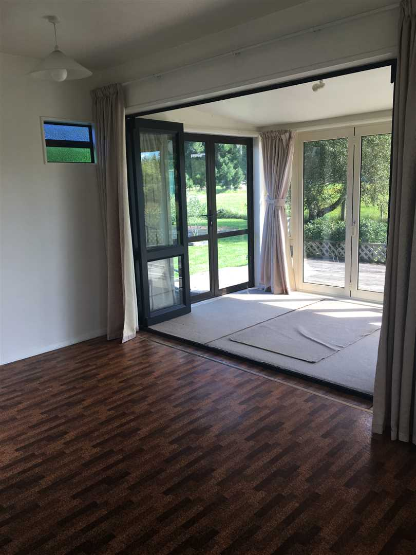 Folding doors to the sunroom/front door