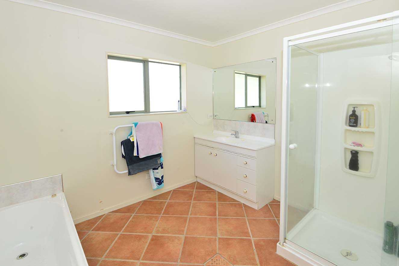 Main Bathroom offering bath and separate shower