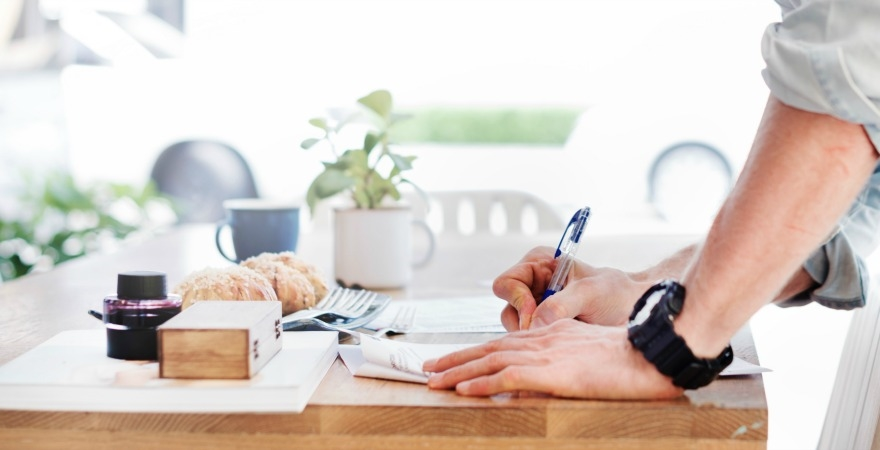 Man signing paperwork
