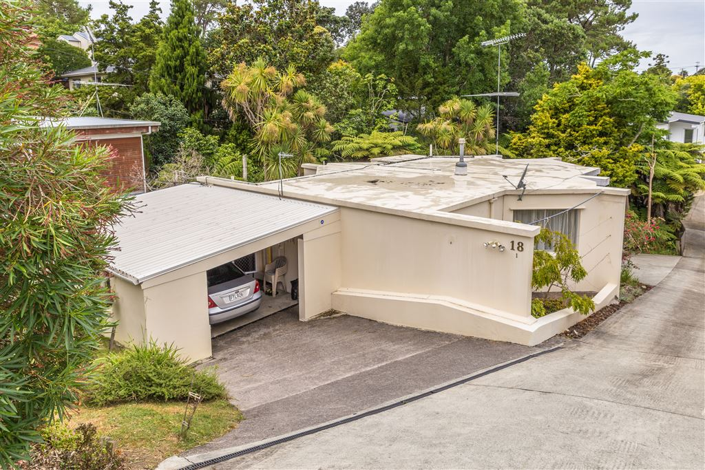 Street view of property showing garage