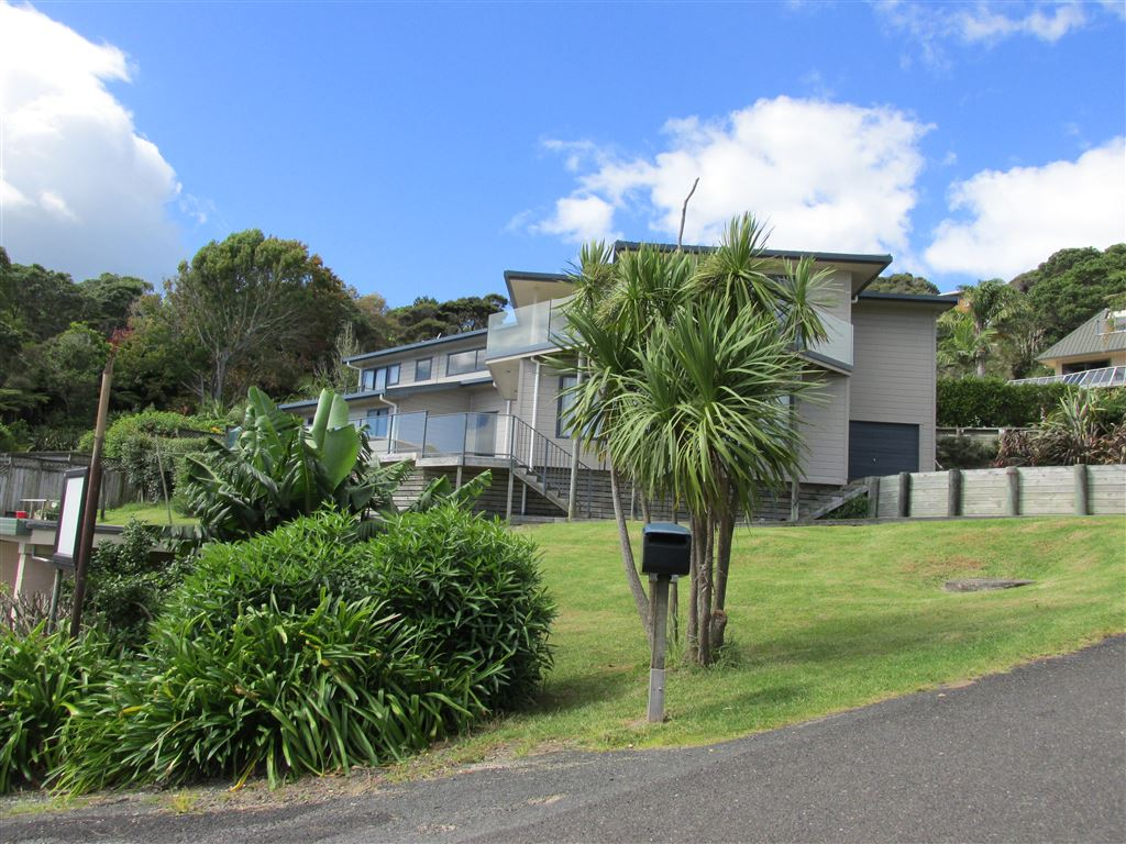 Substantial home with 5 bedrooms, 4 bathrooms and 2 living areas. Views and easy walk to Coopers Beach