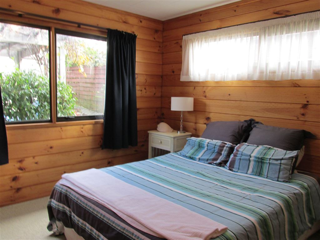 Second bedroom, has hand basin. Looks to Pergola