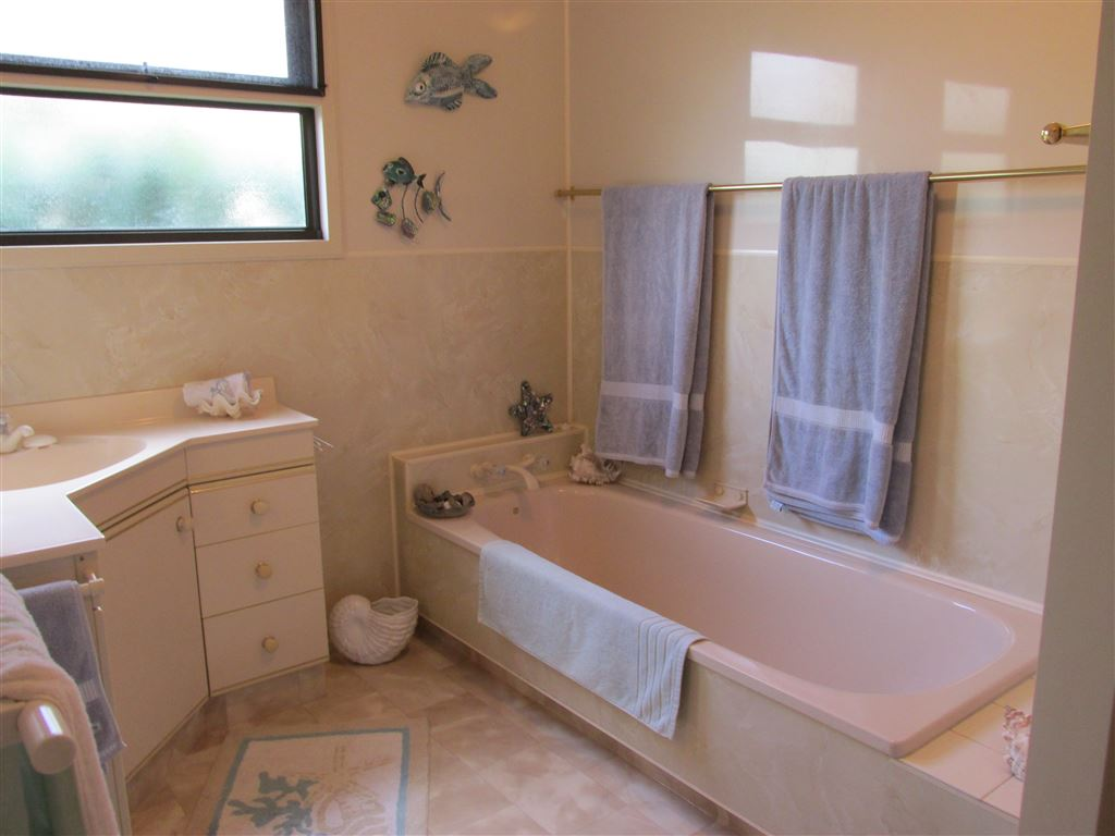 Bathroom with bath and separate shower