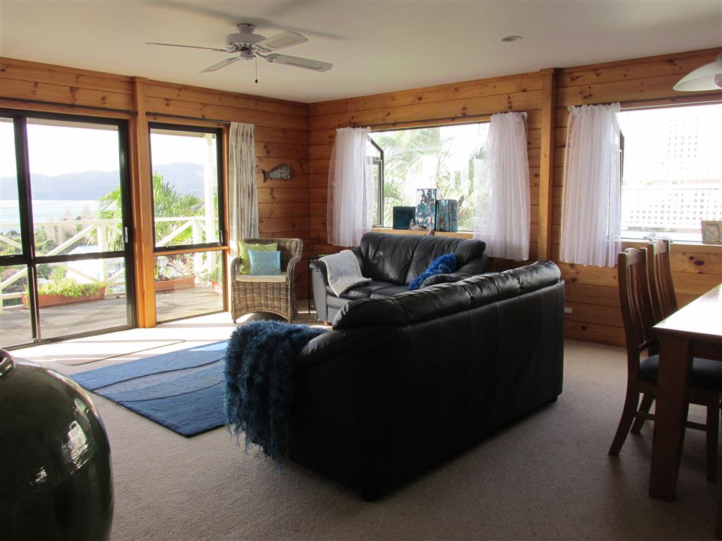 Spacious open plan living area opens onto deck