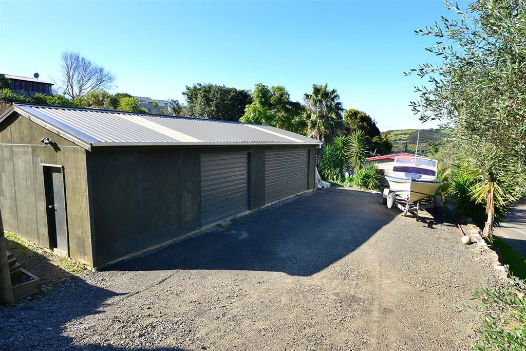3 car garaging and workshop could be converted to 4 car garaging.