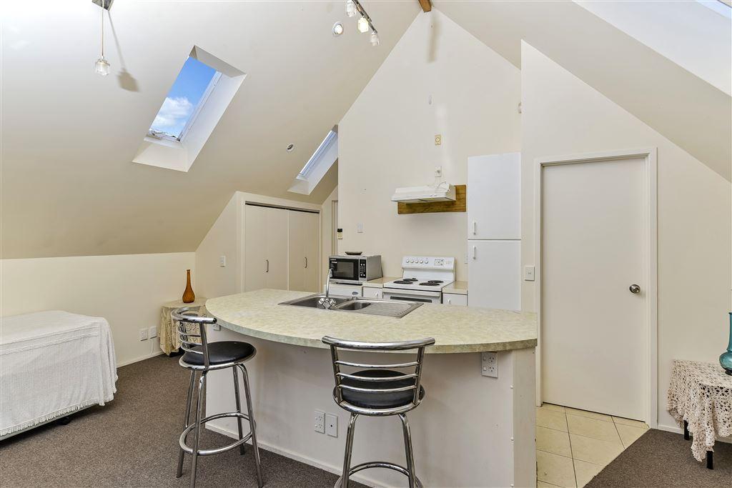 Minor Kitchen.  Laundry behind cupboard doors on left