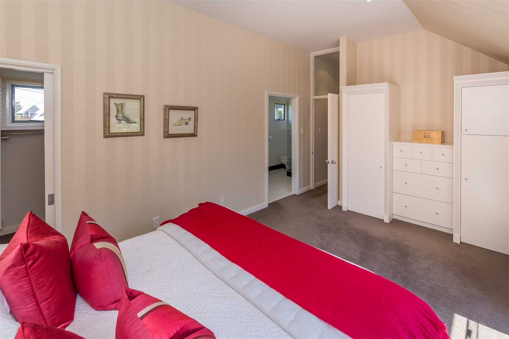 Bedroom 1 with walk in wardrobe, built in wardrobes, ensuite and balcony