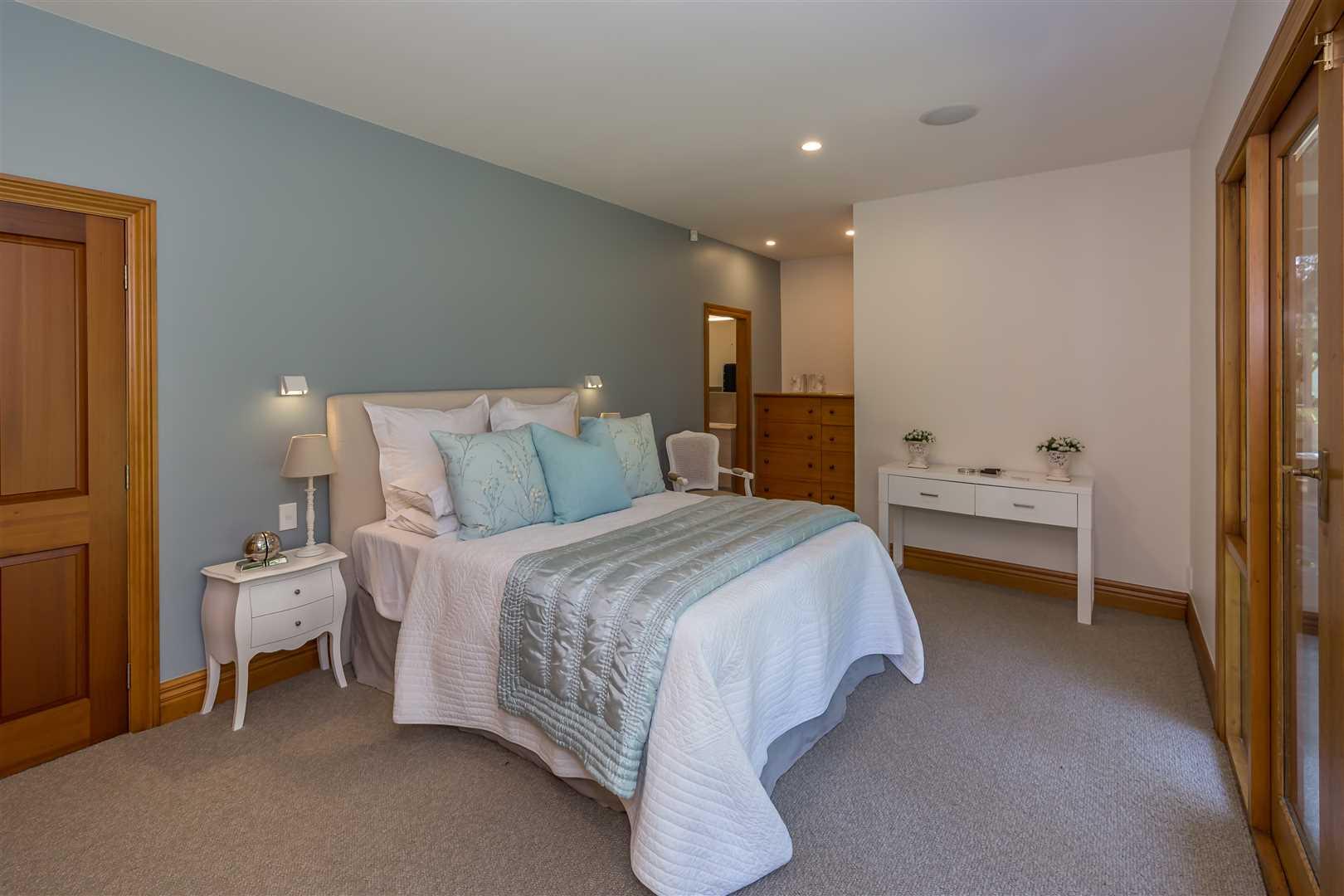 Bedroom 1 with ensuite, walk in wardrobe, patio access
