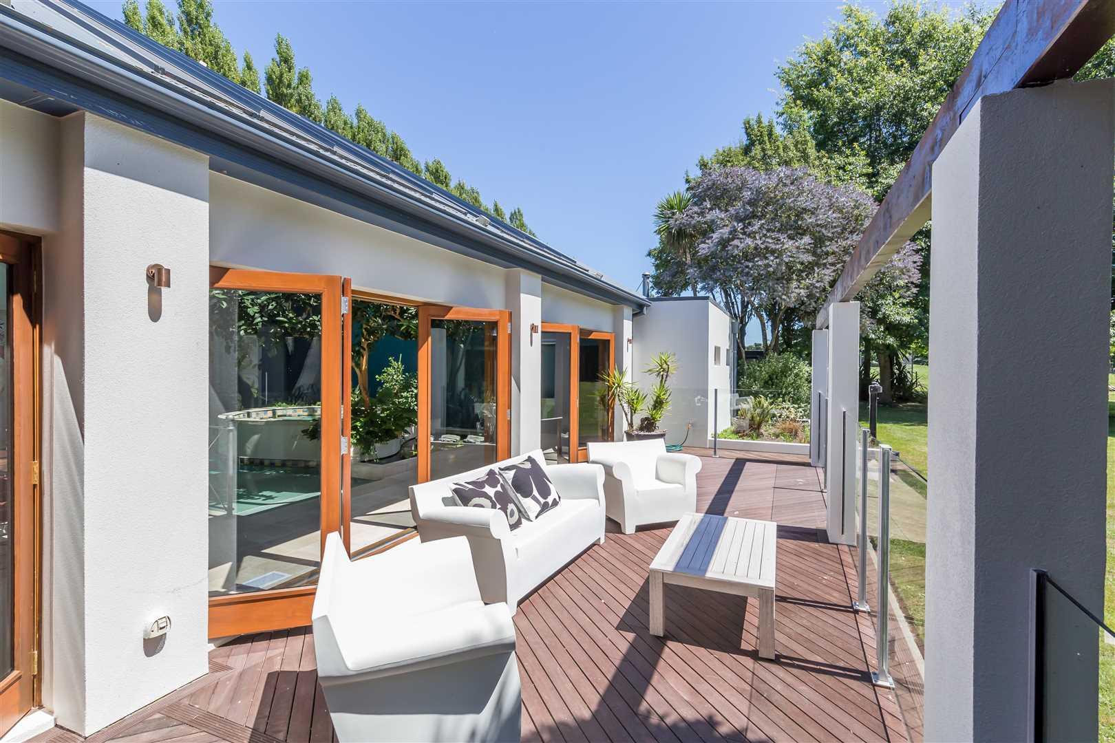 Wonderful outdoor living adjoins the pool room