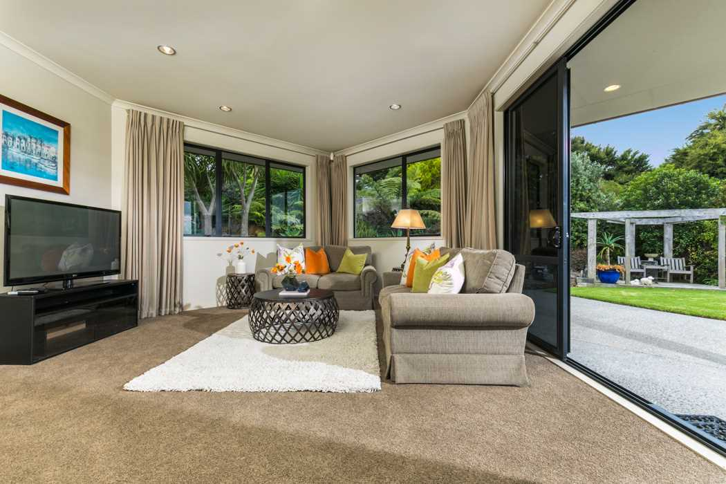 Formal living area, opening up through double ranch sliding doors to the entertainment area outside.