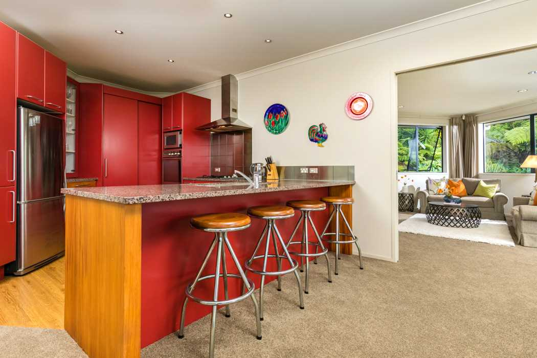 Kitchen with granite bench top and breakfast bar.