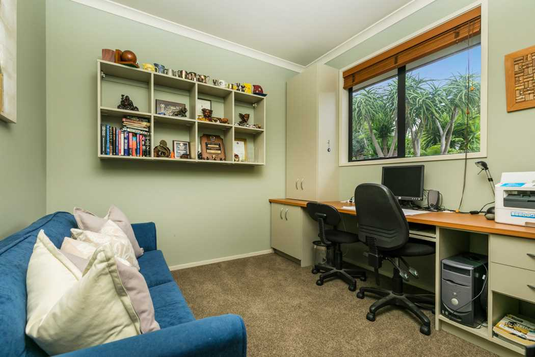 Double bedroom that is currently being used as a home office.