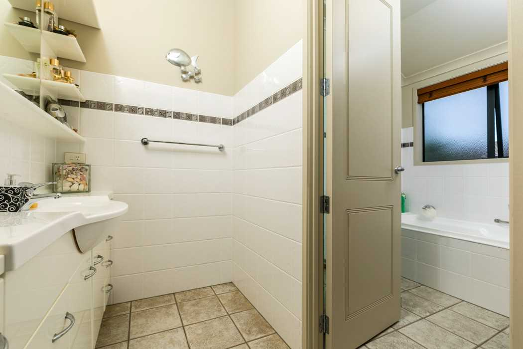 Main bathroom with bath and standalone shower. Separate toilet next door.
