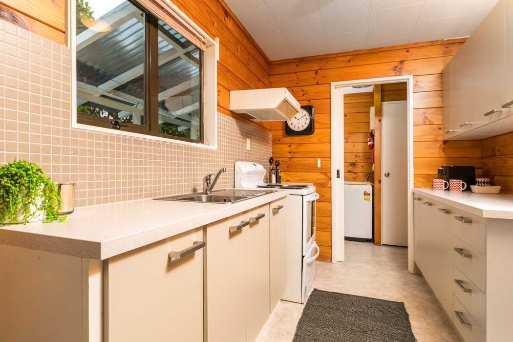 The recently renovated kitchen connects to a separate laundry.