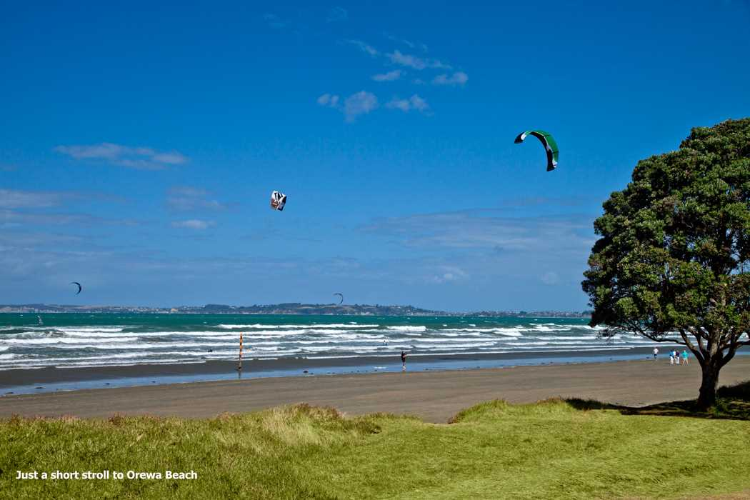 Embrace being a few blocks from the sandy shores of Orewa Beach.