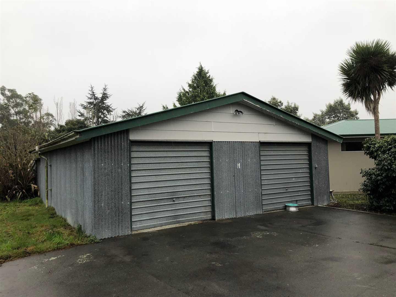 Garage next to house.