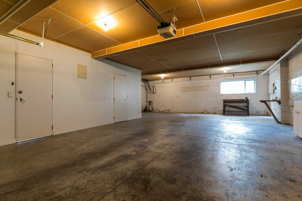 Spacious basement garaging can accommodate up to four cars...