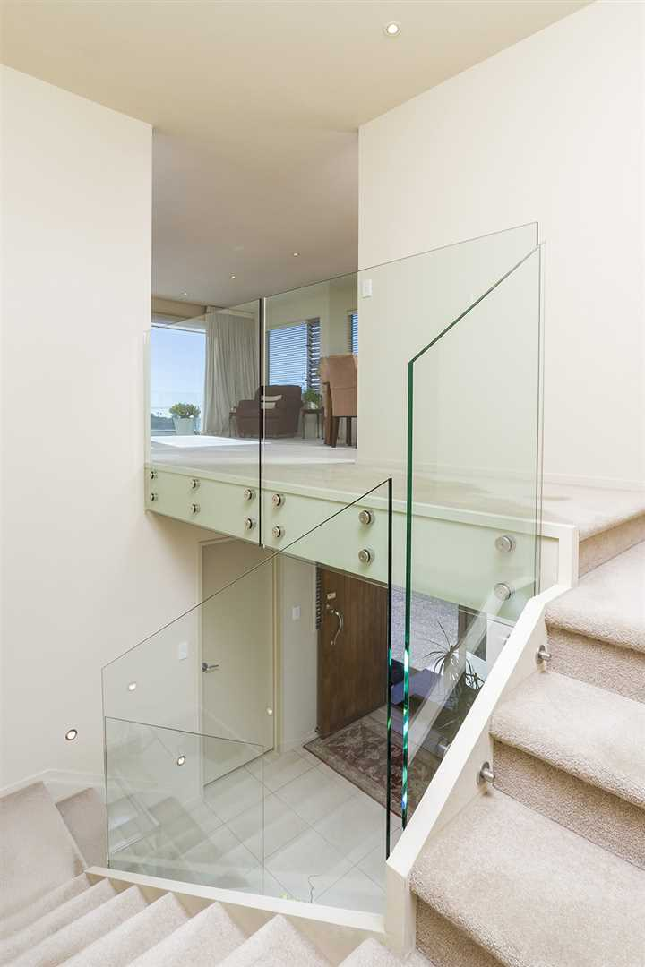 An attractive large stairwell provides the perfect place to show case large pieces of artwork
