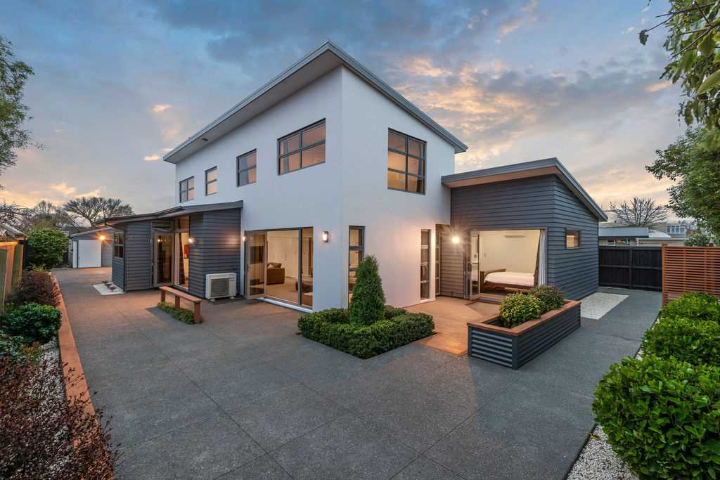 Stunning Modern Home with Four Car Garaging!
