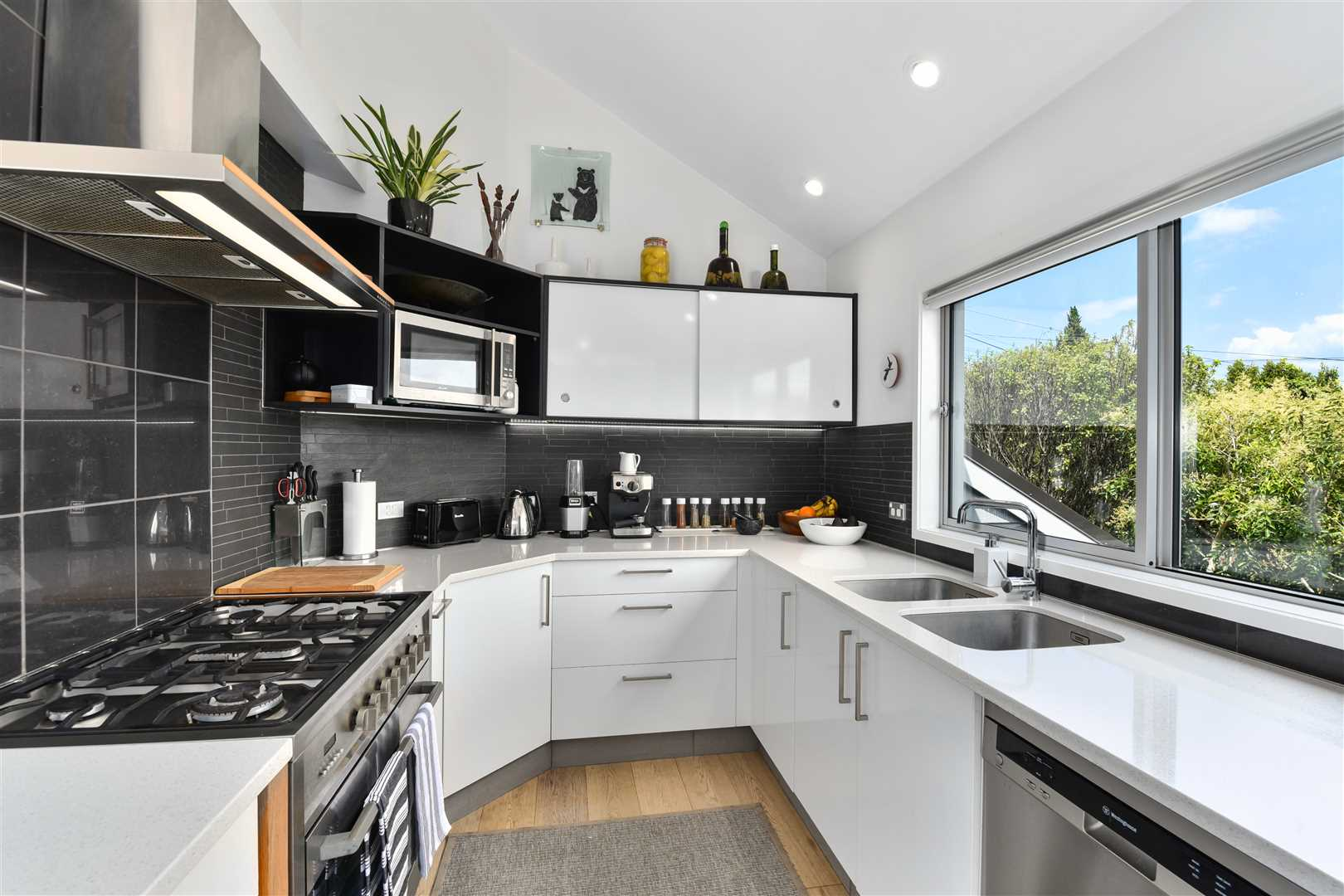 Stylish and very well appointed kitchen with pleasant views and good connection to the living area.