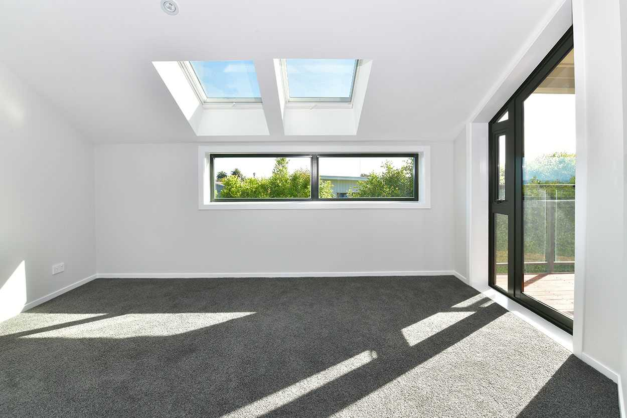 Enjoy a sunny bedroom that flows to  ...