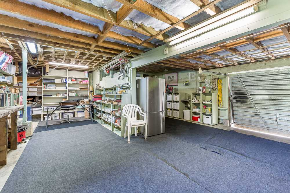 single garaging and masses of storage and workshop space
