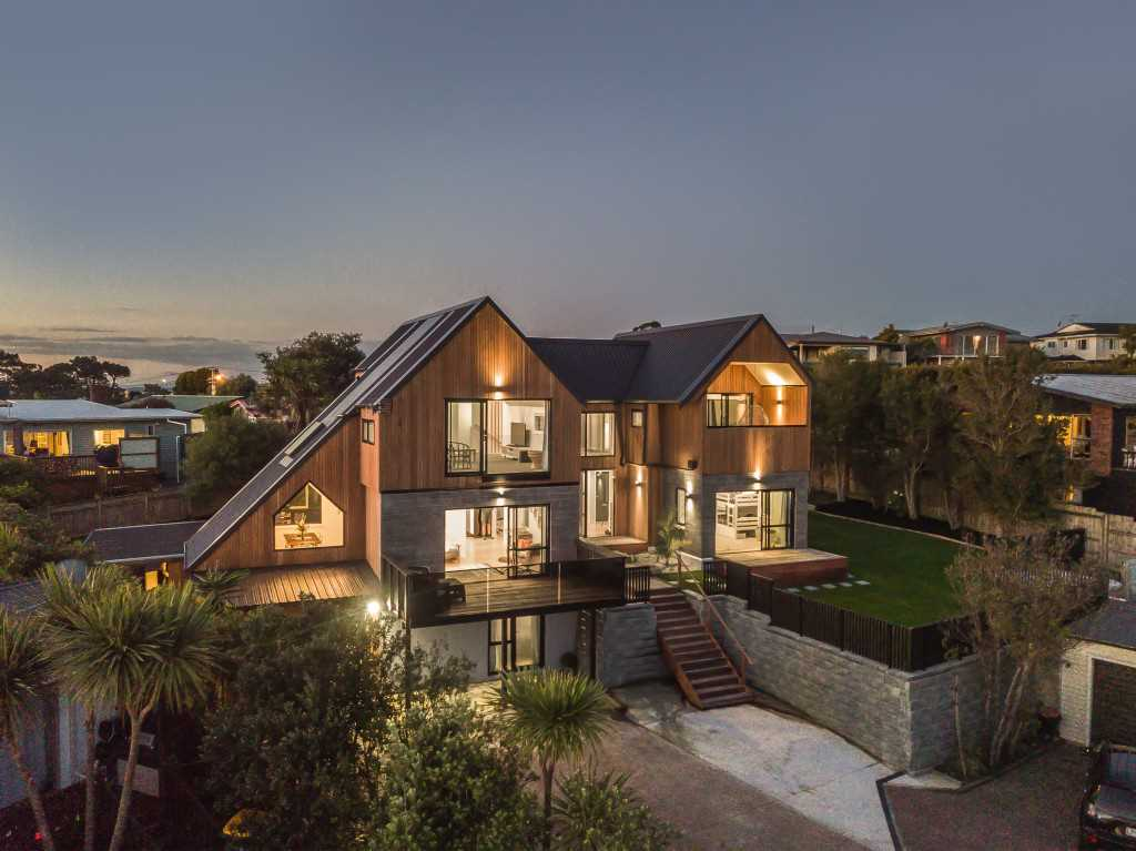 Stunning front view of the property at twilight