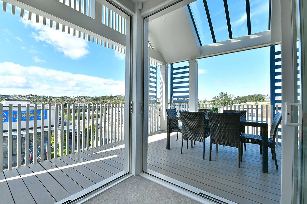 Enjoy expansive views from the covered deck ...