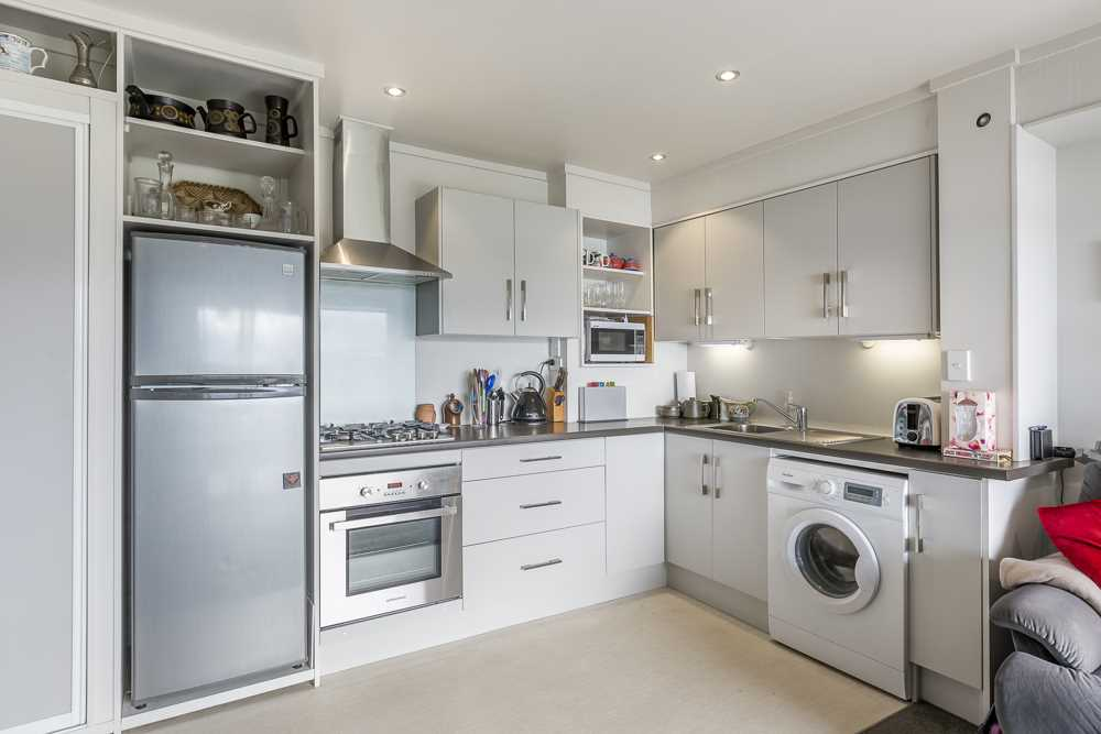 well appointed kitchen and living