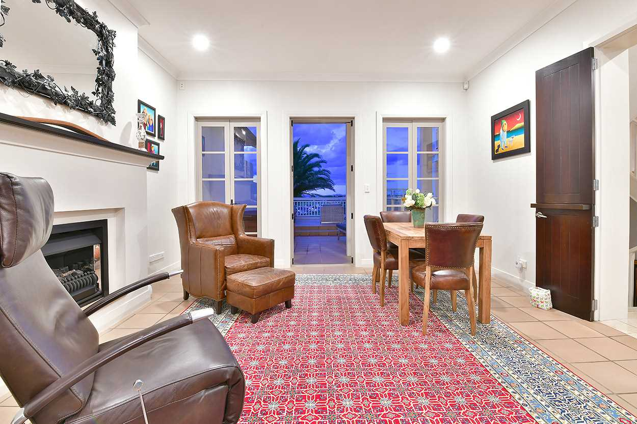 ... with a casual dining area in the kitchen/family room that flows to the pool deck