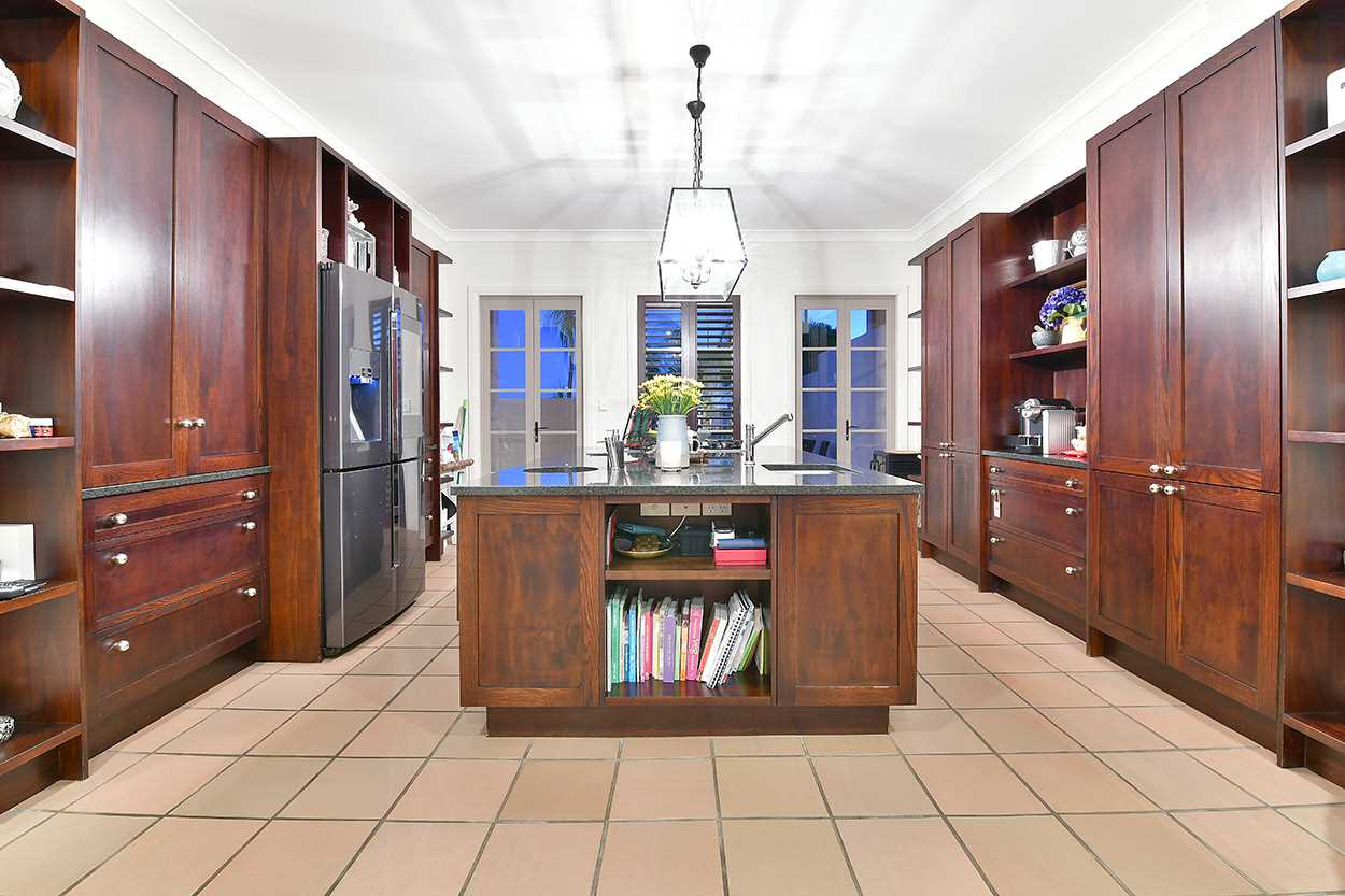 ... and the kitchen has a patio through the french doors for enjoying breakfast in the sun